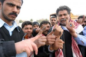 Iraqi voters show inked fingers. CC license: Wikimedia
