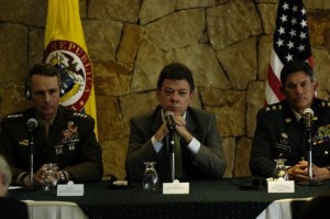 Colombian President Juan Manuel Santos flanked by U.S. military.