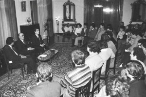 Albanian communist party head Ramiz Alia, center, meeting students on December 11, 1990, to announce the legalization of political parties. (c) ATA