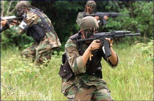 Paramilitary gunmen in Colombia; via flickr