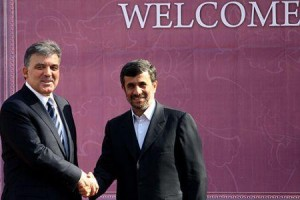 Turkish President Abdullah Gul shakes hands with his Iranian counterpart Mahmoud Ahmadinejad in Tehran on February 14, 2011.