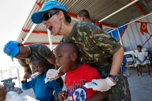 Members of the Brazilian battalion of the United Nations Stabilization Mission in Haiti (MINUSTAH) teach a group of local children proper dental care
