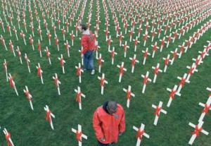Activists place white crosses bearing red ribbons at the Museumplein in Amsterdam, The Netherlands; photo: EPA
