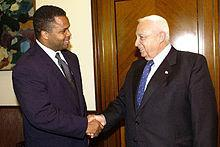 Jesse Jackson, Jr. shaking hands with former Israeli Prime Minister Ariel Sharon on a 2003 trip to Israel