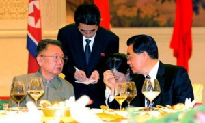 North Korean leader Kim Jong Il (left) confers with Chinese leader Hu Jintao