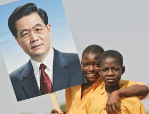 African youth carry a picture of Chinese premier Hu Jintao