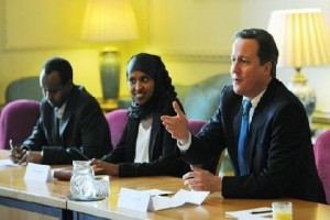 British Prime Minister David Cameron (R) takes part in a round table discussion at 10 Downing Street in London, as he meets members of the London Somali community. Picture courtesy of Reuters.