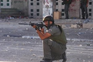 Israeli soldier in the West Bank; photo courtesy IMEMC