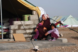 A Kurdish mother with her two daughters at the Domiz refugee camp. Although the immediate family feels safe at the camp, the mother said she is worried about the relatives they left behind in Syria. We sold so many of our things to get here, the mother said. All that we have left is our children. © 2012 Samer Muscati/Human Rights Watch