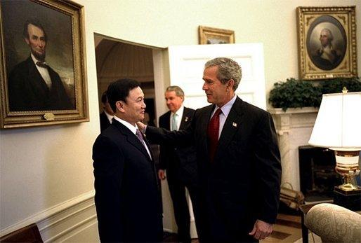 Former Thai Prime Minister Thaksin Shinawatra visiting with George Bush in the Oval Office, 2002. Image Wikimedia Commons