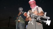 Iraqi insurgents with guns