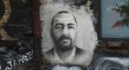 Image on wall of Islamic State head Abu Bakr al-Baghdadi, beneficiary of misconceived U.S. policies. (Photo: Thierry Ehrmann / Flickr)