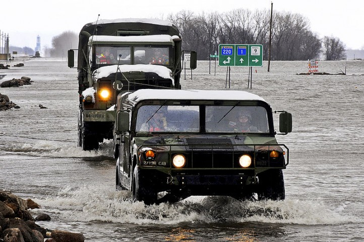 800px-National_Guard_trucks_ford_flood_in_Minnesota