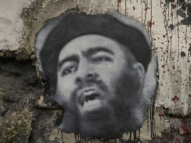 Onerous economic conditions in the Islamic State help fuel the refugee crisis. Pictured: Islamic State leader Abu Bakr al-Baghdadi. (Photo: Thierry Ehrmann / Flickr Commons)
