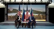 Barack Obama and Vladmir Putin shake hands at G8 summit 2013