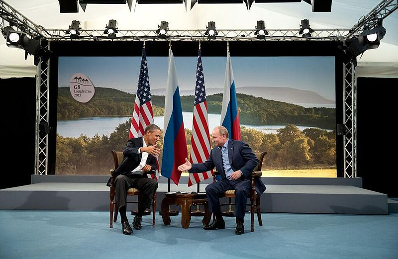 Barack Obama and Vladmir Putin shake hands at G8 summit 2013