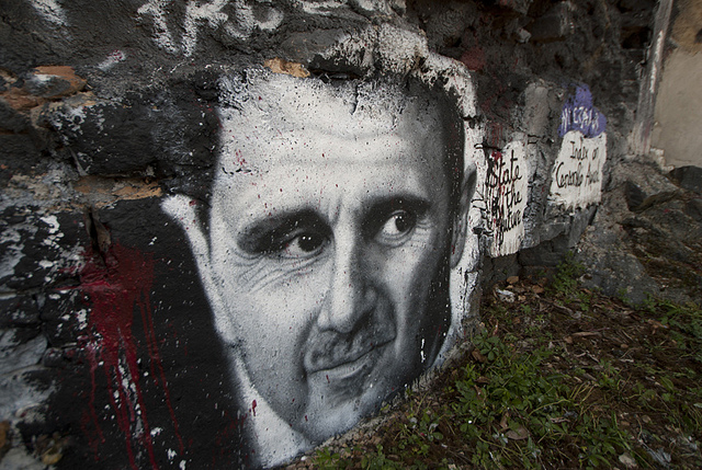 It's difficult to understand not only what drives a man like Assad to commit such atrocities, but why states like the U.S., Russia, and Iran would prop up a regime such as his. (Photo: Thierry Ehrmann / Flickr Commons )