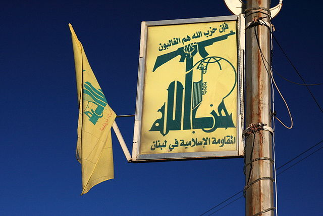To a certain extent Hezbollah and Hamas have gone legit. Pictured: Hezbollah flag and signage. (Photo: Yeowatzup / Wikimedia Commons)