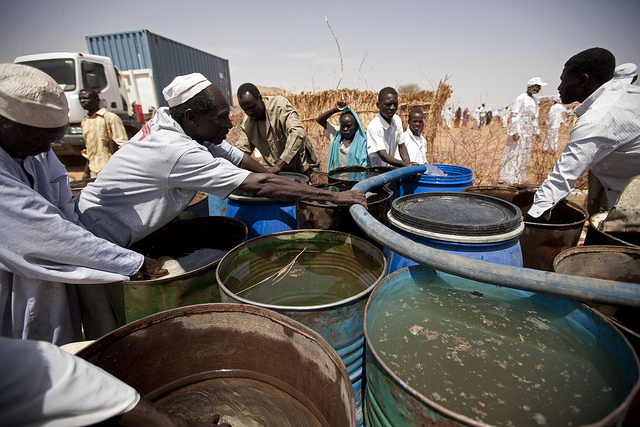 Global warming can lead to wars for resources similar to the one that Hitler waged on Russia. Pictured: Water distribution in Darfur. (Photo: UNAMID / Flickr Commons)
