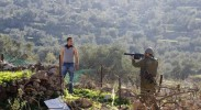 Israeli soldier points gun