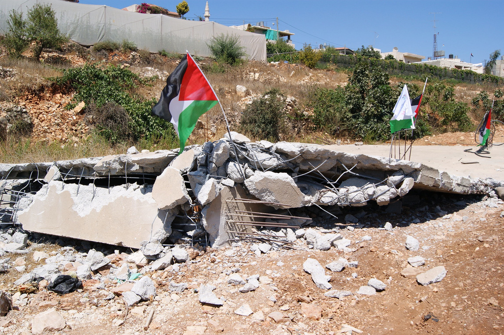 A bulldozed Palestinian home in the village of Beit Ommar. (Source: Palestine Solidarity Project / Flickr)