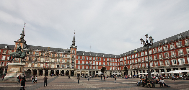 Spain's woes began with the American banking crisis of 2007-08, which crashed Spain's vast real estate bubble and threatened to bring down its financial system. Pictured: Plaza Mayor, Madrid. (Photo: Rick Ligthelm / Flickr Commons)