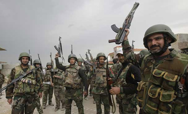 The Assad regime and the Nazis is not an unfair comparison. Pictured: the Syrian  Army. (Photo: the Indian Express)