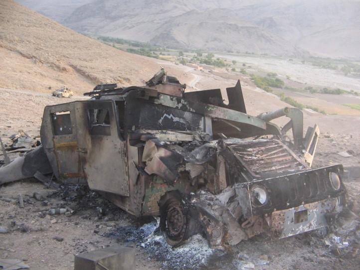 The costs of war, in every way, have become prohibitive. Pictured: a Humvee destroyed in an attack. (Photo: Hoggard Films)