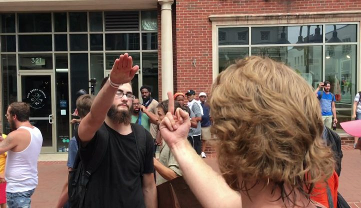 Neo-Nazis stand off with anti-racist protesters in Charlottesville. (Photo: Evan Nesterak / Flickr)